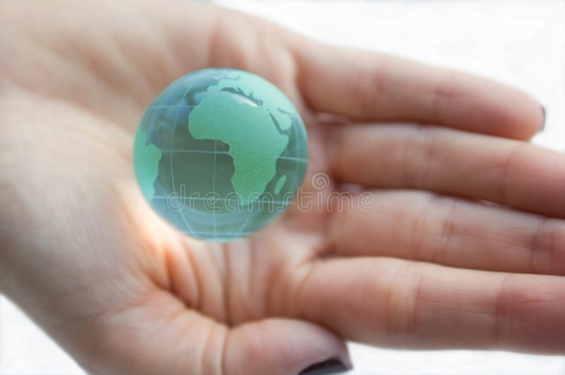 Earth globe (Africa view) in female hands. stock photography