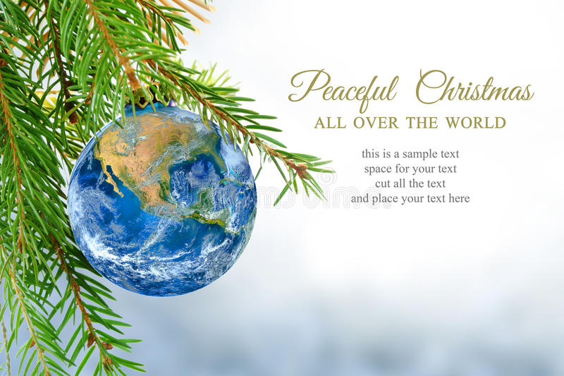 Earth globe as christmas bauble, metaphor for universal peace, e. Earth globe as christmas ball hanging on fir branch, message: peaceful Christmas all over the stock images