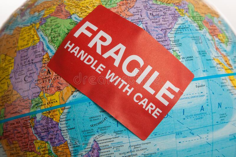 An Earth globe with a fragile hand with care sticker royalty free stock image