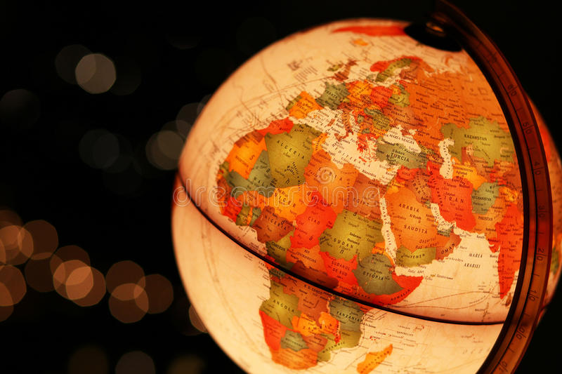 Earth globe glowing in dark sky. Earth over Africa and Europe represented by glowing desk globe in black sky closeup royalty free stock photography