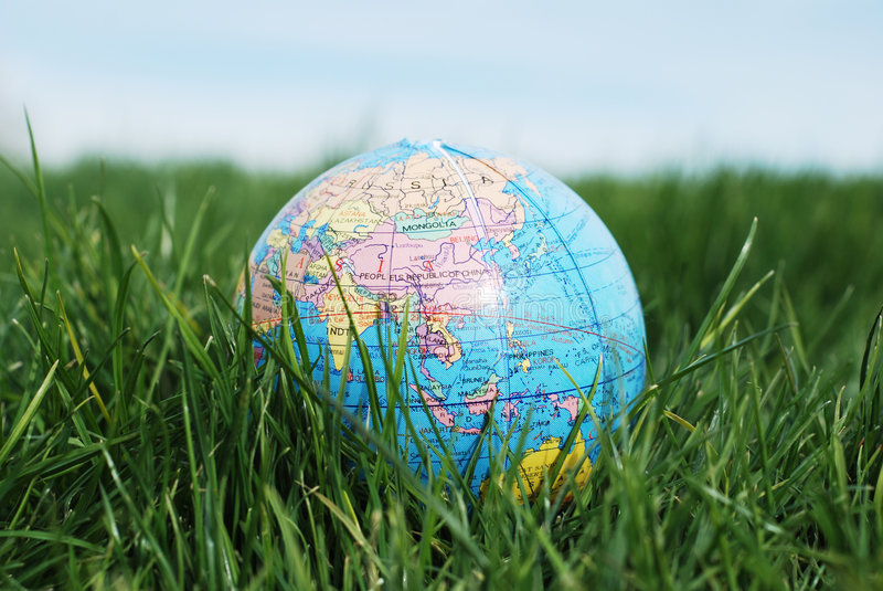 Earth on grass royalty free stock image