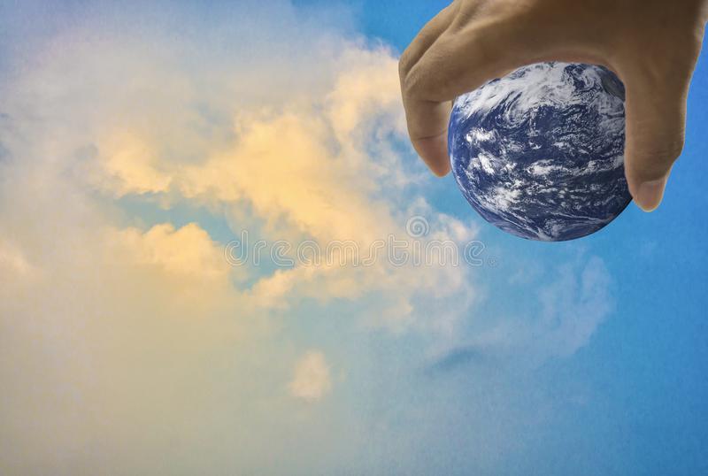 Earth, in a handful, With bright sky as the background stock photo