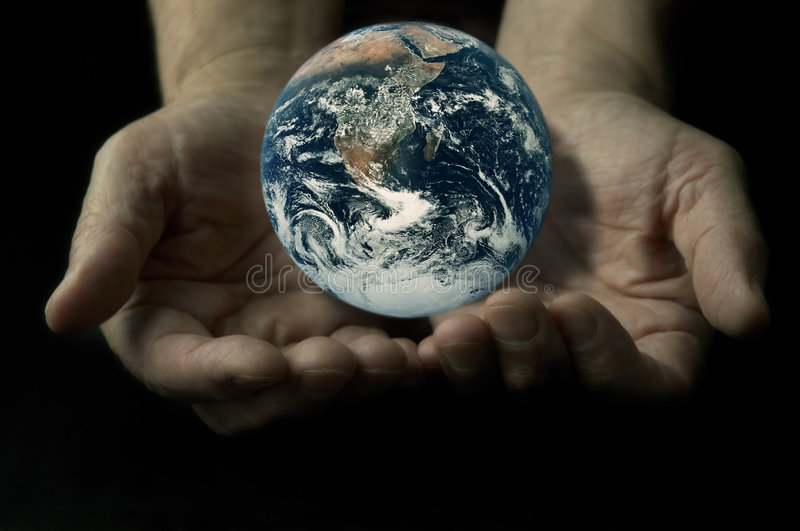 Earth on the hands royalty free stock image
