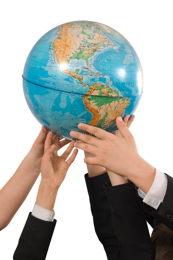 Earth in the hands of children. stock photo