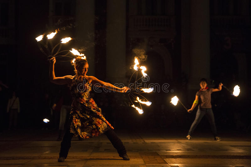 Earth hour fire show girl stock images