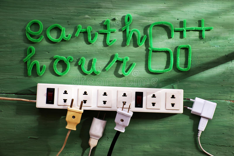 Earth hour message, turn off electrical equipment. Earth hour message on green background for special day, a day to remind people give hand save the earth, green royalty free stock photography