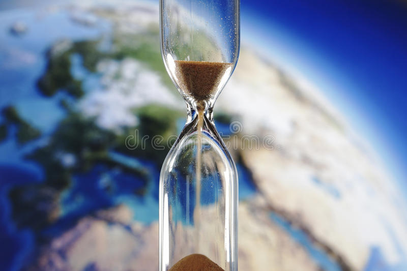 Earth and hourglass royalty free stock photos