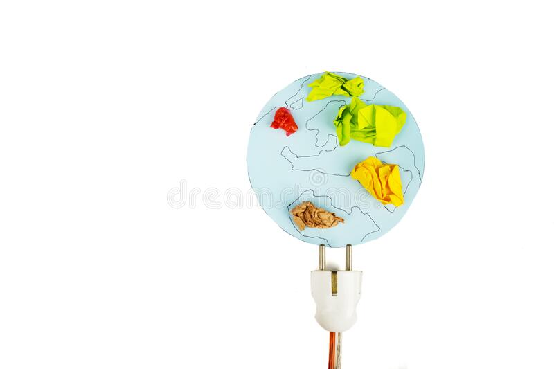 Earth map from crumpled paper with electric plug. Top view of earth map from crumpled paper with electric plug, isolated on white background royalty free stock photo