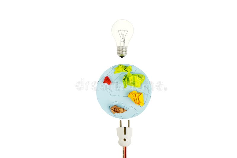 Earth map with electric plug and light bulb. Flat lay of earth map from crumpled paper with electric plug and light bulb, isolated on white background royalty free stock photo