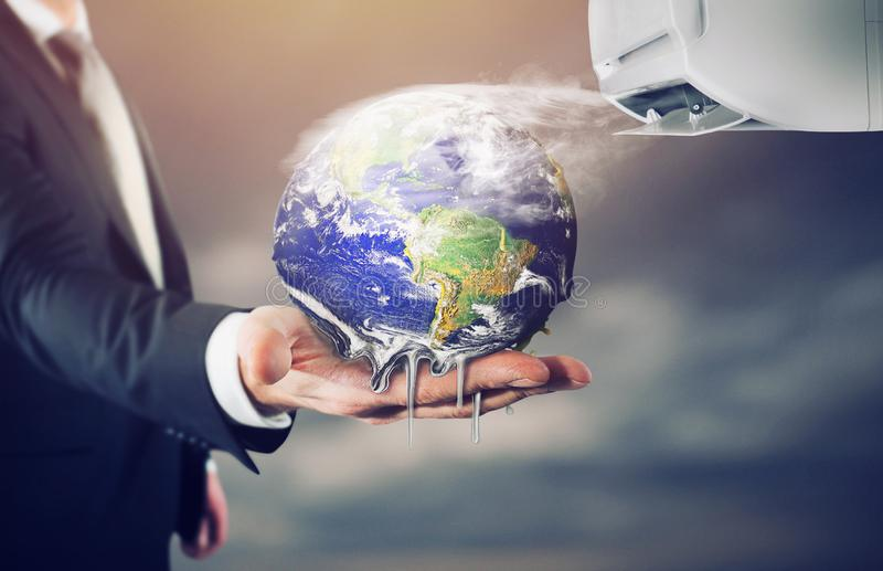 The Earth is melting. stop global warming. World provided by NASA. Businessman holding Earth that melt . stop global warming. World provided by NASA stock image