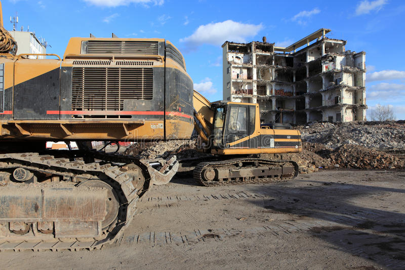 Earth Mover And Industrial Ruins Royalty Free Stock Photos