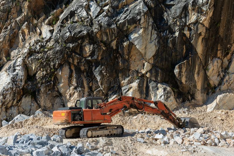 Earth Mover in a Marble Quarry - Carrara Italy stock images