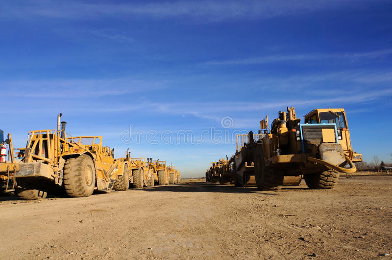 Earth Movers grading surfaces