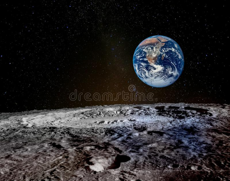 Earth rises above lunar horizon. royalty free stock photo