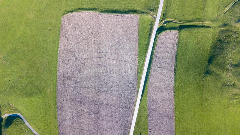 Earth`s line. A drone vertical perspective of the ground`s colors and shapes. Agricultural fields. Texture stock images