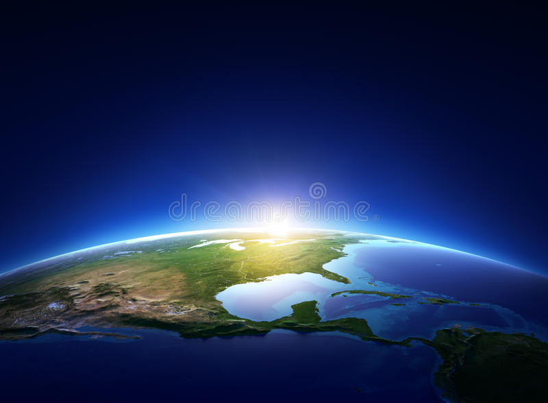Earth sunrise over cloudless North America. (Elements of this image furnished by NASA royalty free illustration