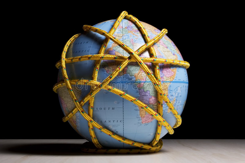 Earth tied up. Earth globe tied up wtih rope royalty free stock images
