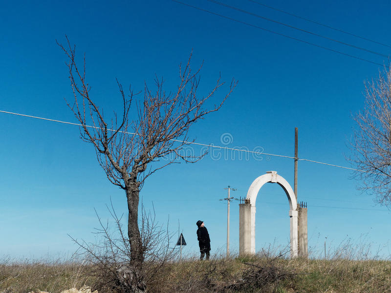 Earth, tree, a man and where a building used to be stock photography