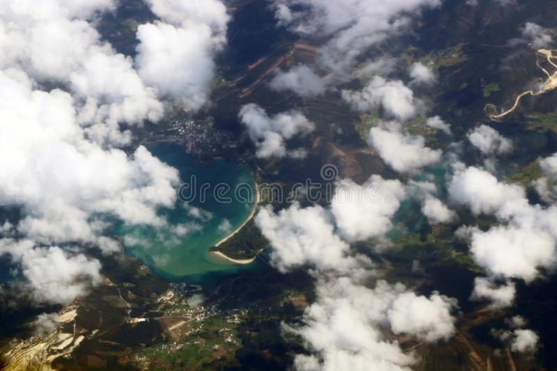 Earth under the white clouds seen from the plane stock image