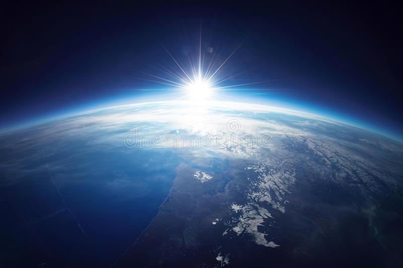 Earth view from space with sunrise. Elements of royalty free stock image