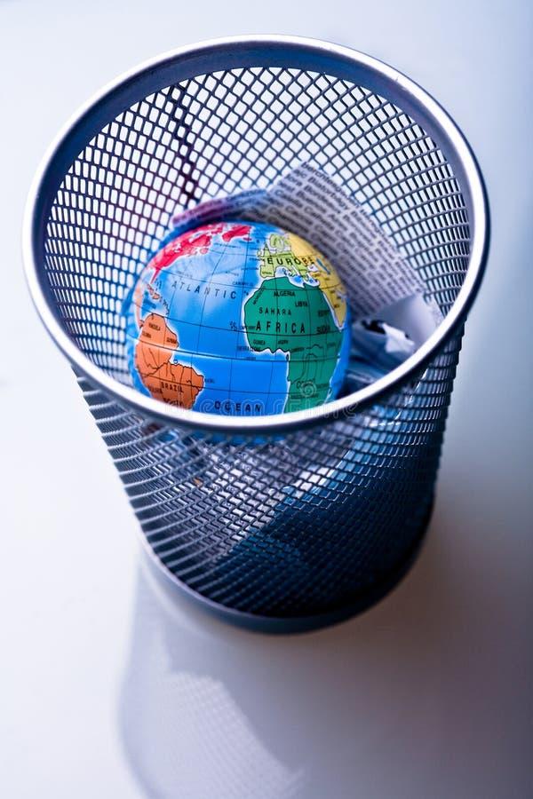 Earth in waste-bin stock images
