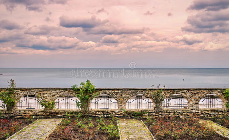 Landmark attraction in Bulgaria. Landscape with earth, water and dramatic sky. Black Sea from Botanical Garden - Balchik. Landmark attraction in Bulgaria. View royalty free stock image