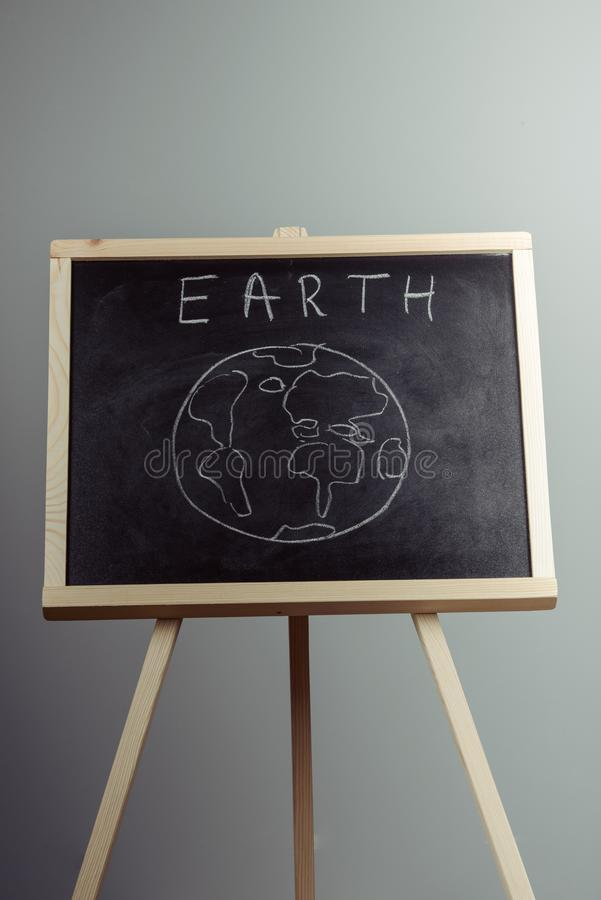 earth written on blackboard with earth symbol, background, high resolution stock photography