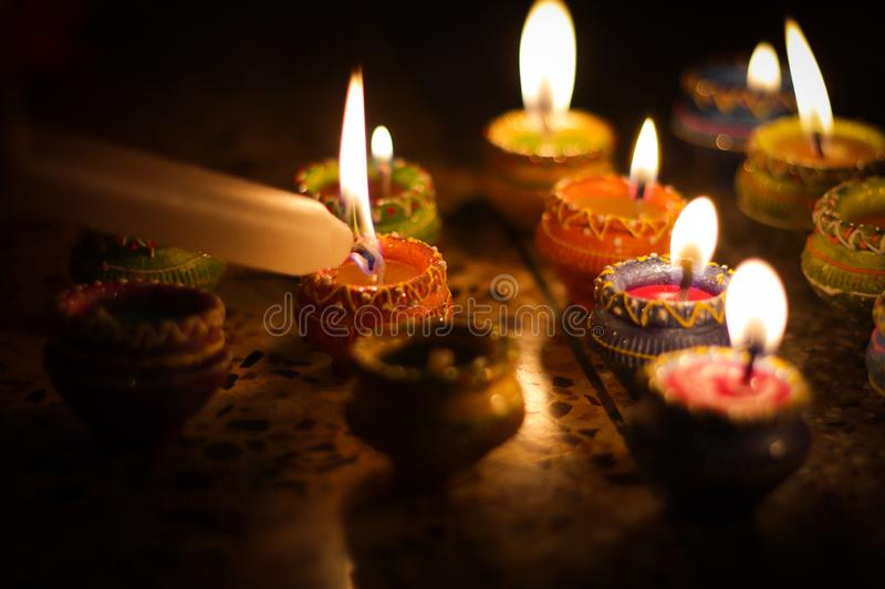 Earthen diya lamp lighting with candles on the occasion of diwali and sandhi pujo stock photo