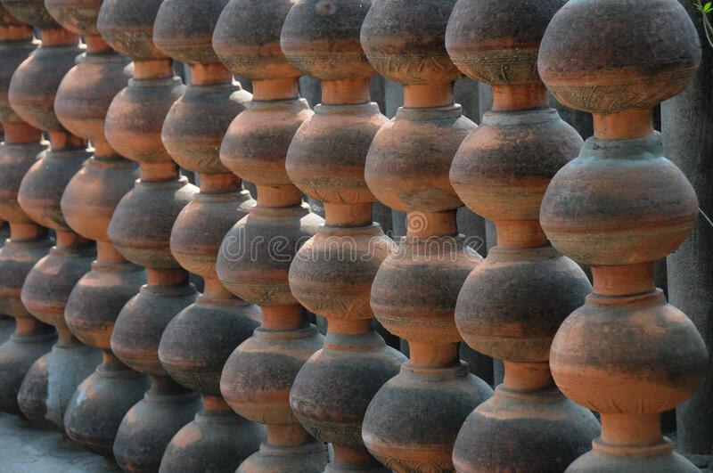 Earthen Pots in the Rock Garden, Chandigarh, India. Designed as a wall in brown and black colour stock images