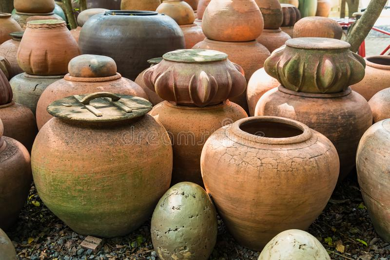 Earthenware handmade old clay pots in Thailand royalty free stock image
