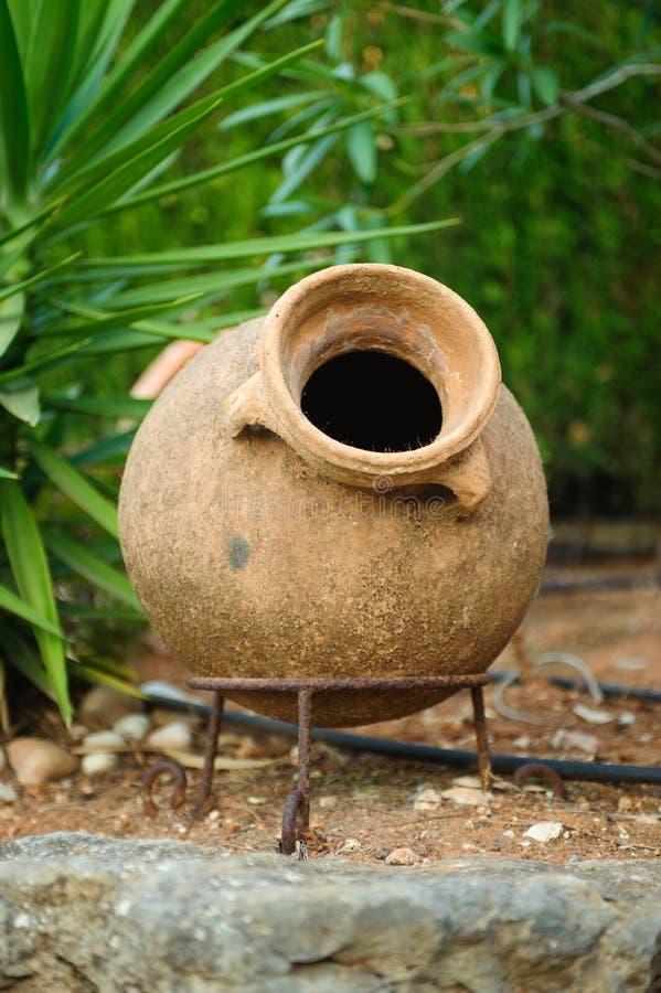 Download Earthenware jar in garden stock photo. Image of gardening - 26338976