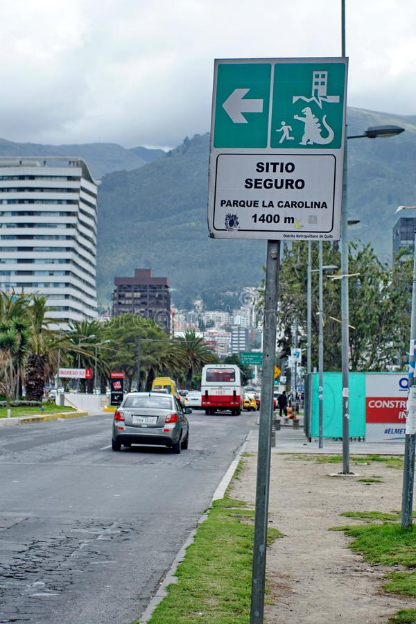 Earthquake evacuation sign in Quito. Earthquake evacuation sign with a godzilla sticker on it in Quito, Ecuador royalty free stock image