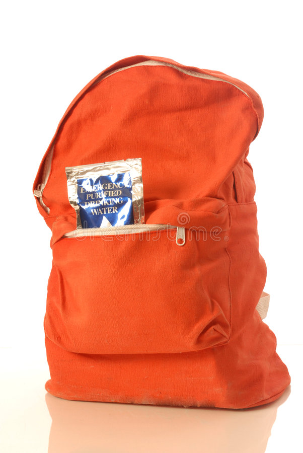 Earthquake survival kit. In orange backpack royalty free stock photography