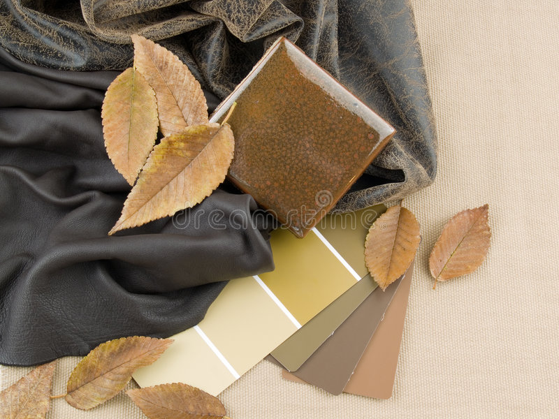 Earthy brownish interior design plan. Handcrafted ceramic tile with two brownish leather samples and paint color swatches stock photos