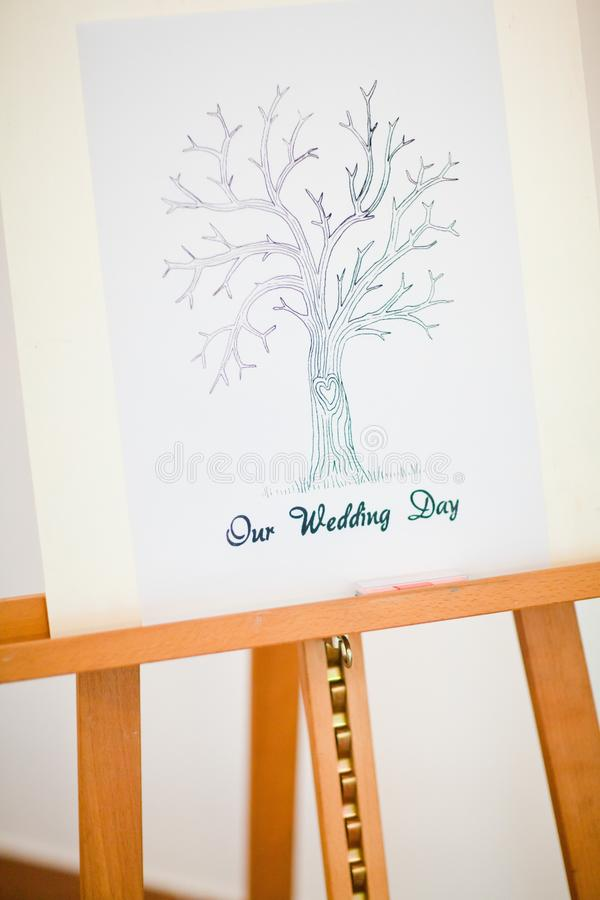 Easel with `Our wedding` day tree for quest stock image