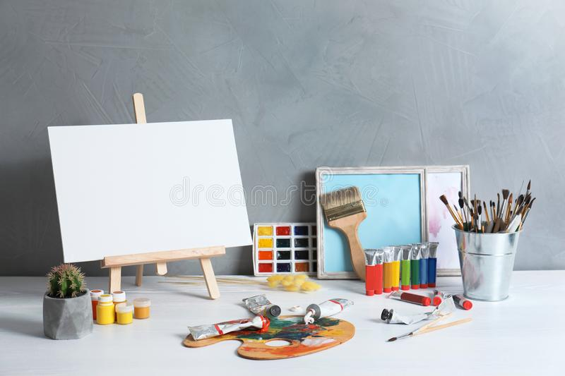 Easel with space for design and set of professional art stock illustration