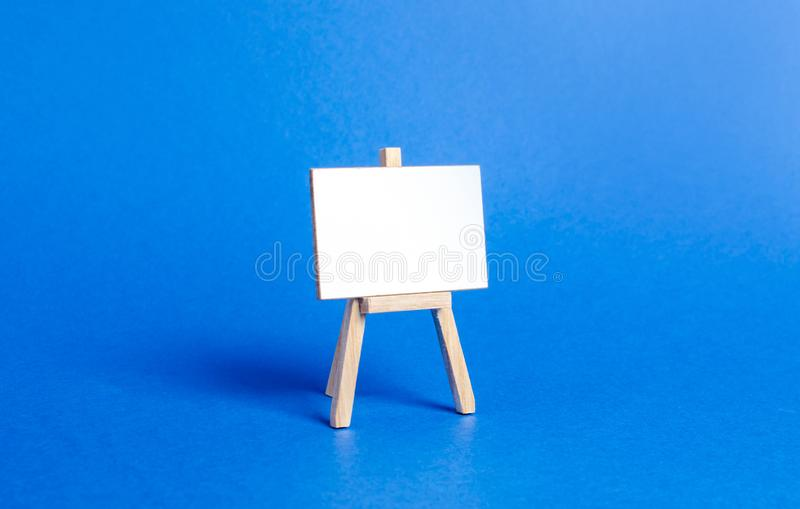 Easel or stand. Minimalism. Business process concept, strategy planning at meetings and briefings. Education, teaching master. Classes and lessons. Presentation stock photo