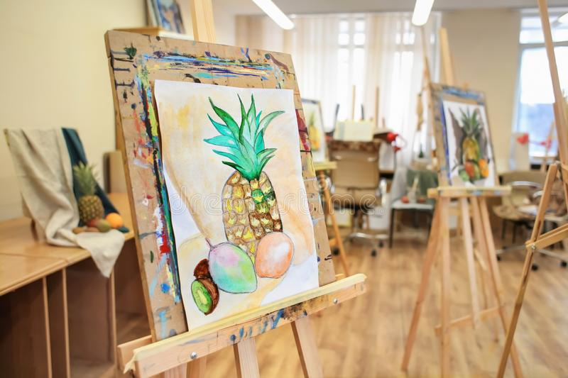 Easel with unfinished still life painting in artist's workshop stock photos