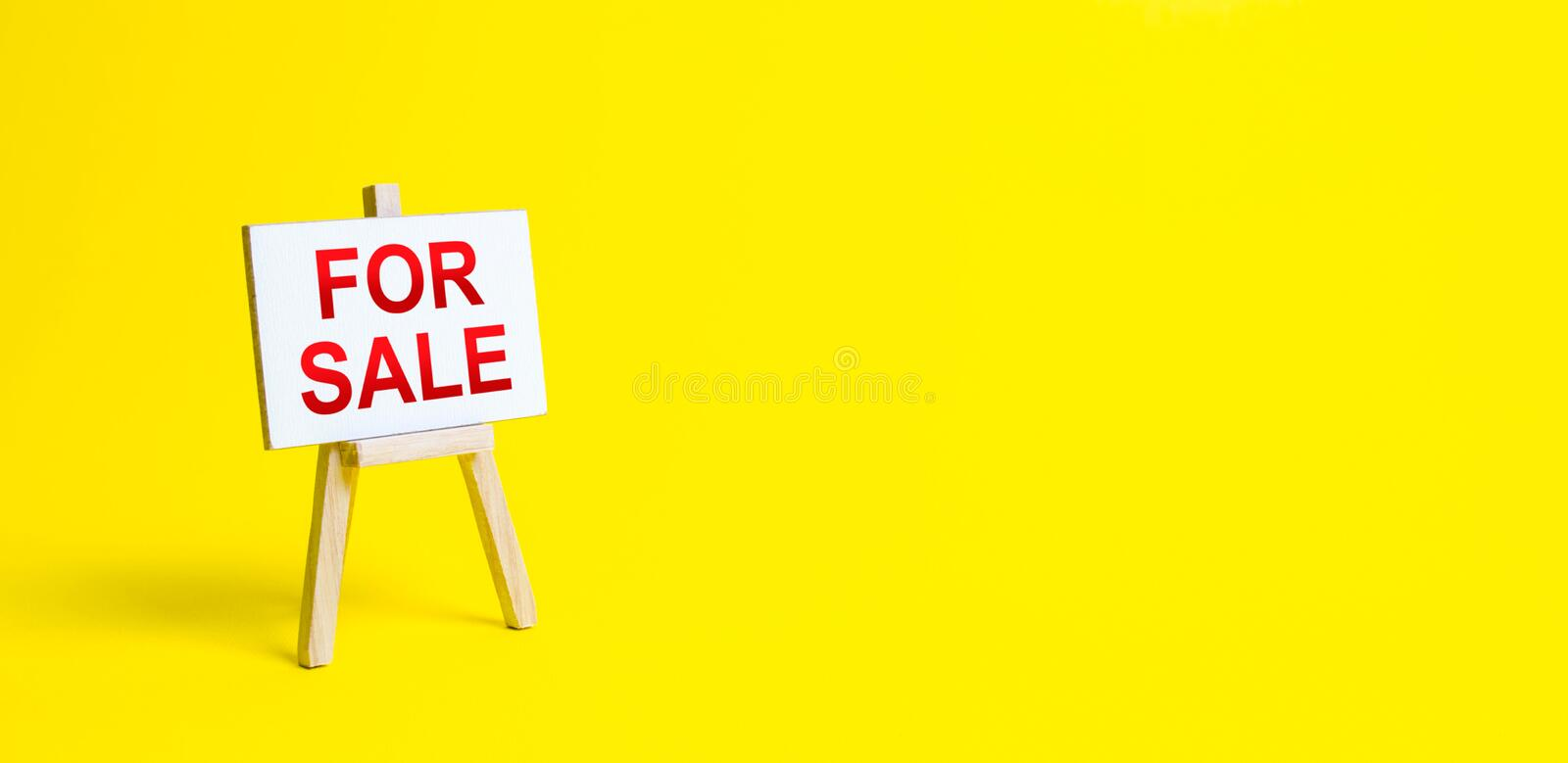 Easel with the words For Sale. Application for the selling of property and real estate. Advertising marketing. Shopping online. Increase sales, attract stock images