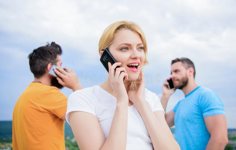 The easiest way to communicate. Mobile phone users. Group of friends talking on cell phones. Modern people with royalty free stock photos