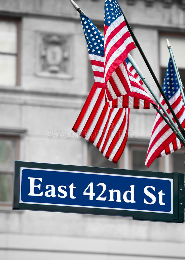 East 42nd Street Signs and US flag. In New York city royalty free stock image