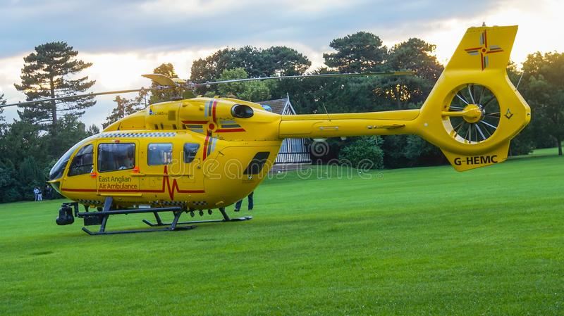 East Anglian Air Ambulance in park royalty free stock photography