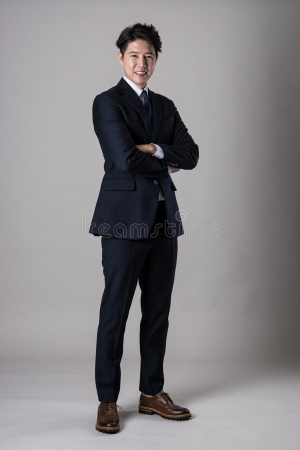 East Asian businessman shooting studio portrait photo royalty free stock image