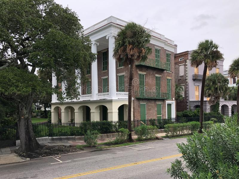 East Bay Street Homes Prepare for the Arrival of Hurricane Dorian. A house directly across from the Cooper River in Charleston, SC is boarded up in stock photo