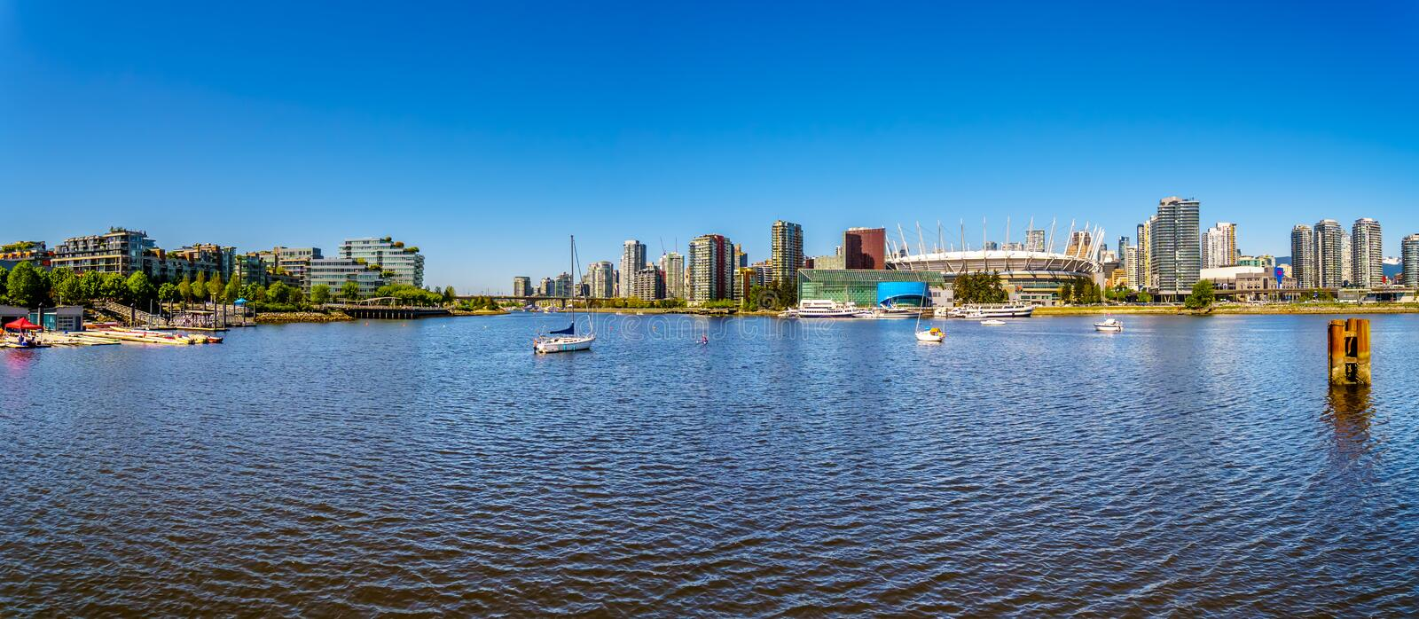 East End of False Creek Inlet in Vancouver British Columbia under clear blue sky royalty free stock photography