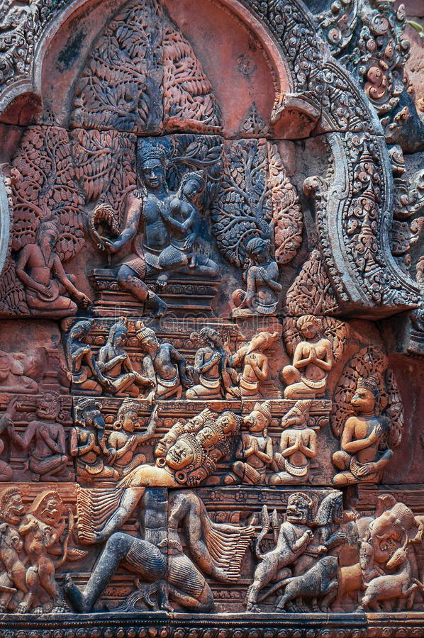 East-facing pediment on Southern Library of Banteay Srei shows Shiva and Uma seated on summit of Mount Kailash royalty free stock photos
