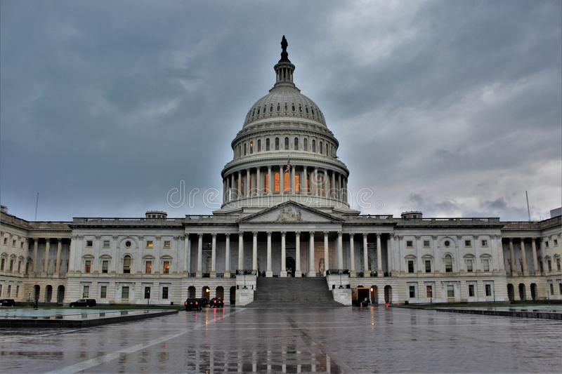 East front of the United States Capitol on a cloudy day. The original building was completed in 1800 and was subsequently expanded, particularly with the royalty free stock image