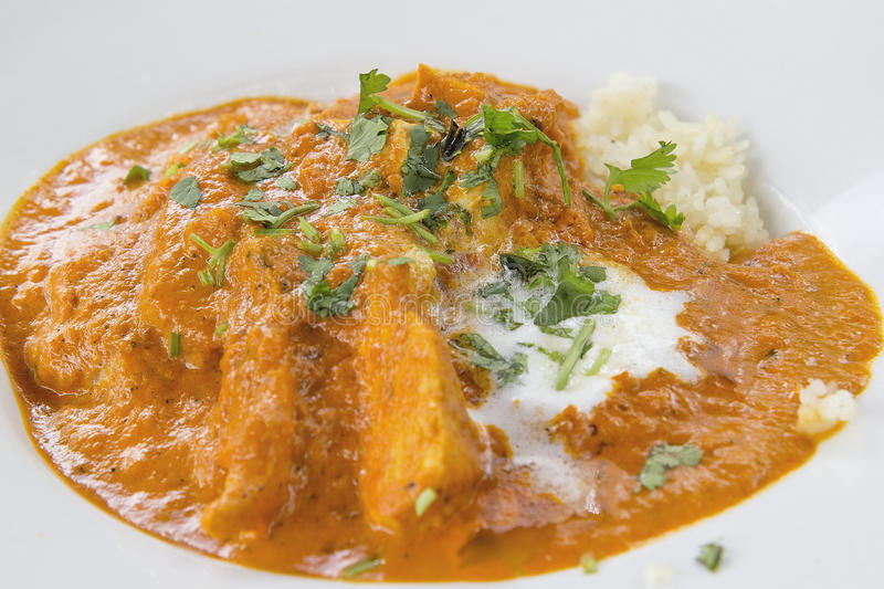 East Indian Butter Chicken Curry with Naan Closeup stock photos