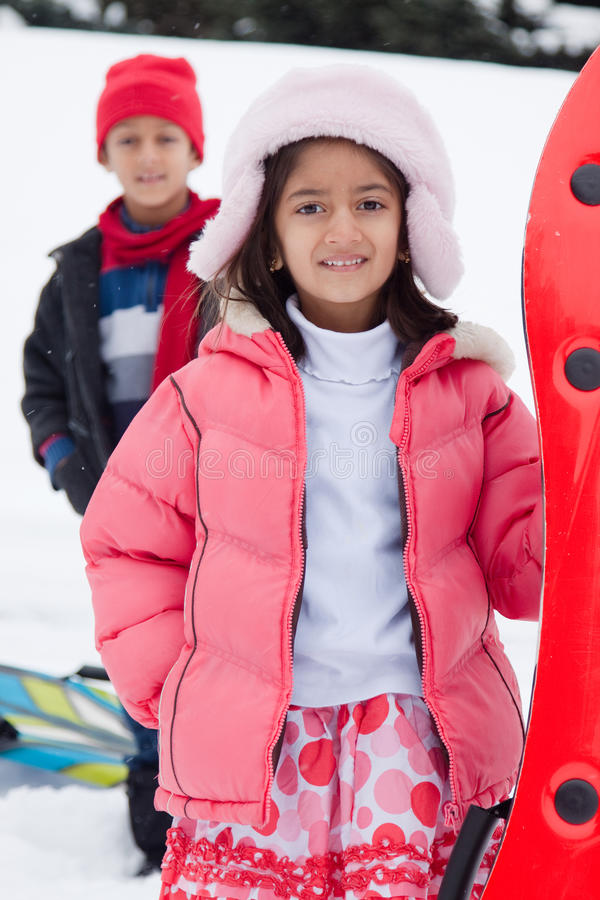 Download East Indian Kids Toboganning In The Snow Stock Photo - Image: 28671946