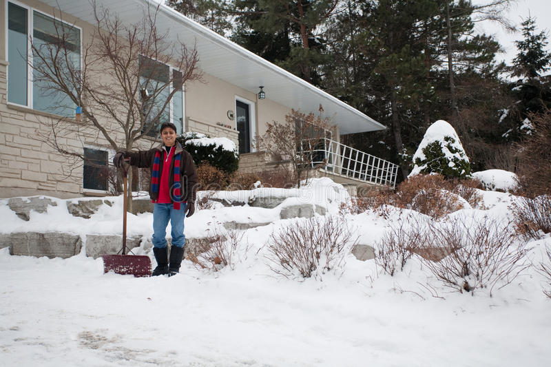 Download East Indian Man Shovelling Snow Stock Image - Image of young, dark: 28671949